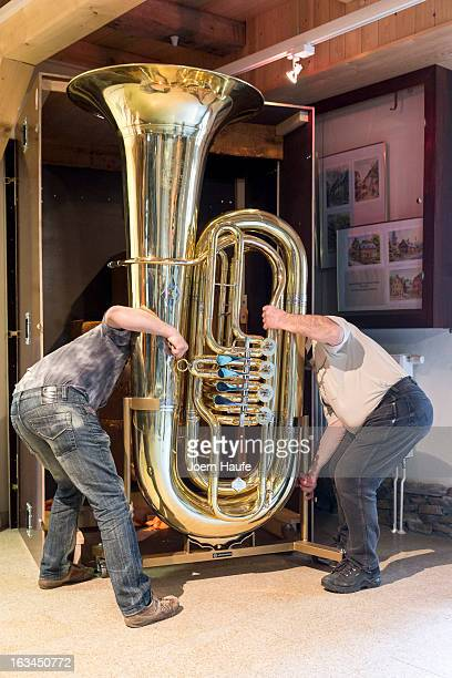 Musical instrument craftsmans Michael Geilert and Hartmut Geilert loaded world's largest functional tuba in a case at the MusikinstrumentenMuseum on...