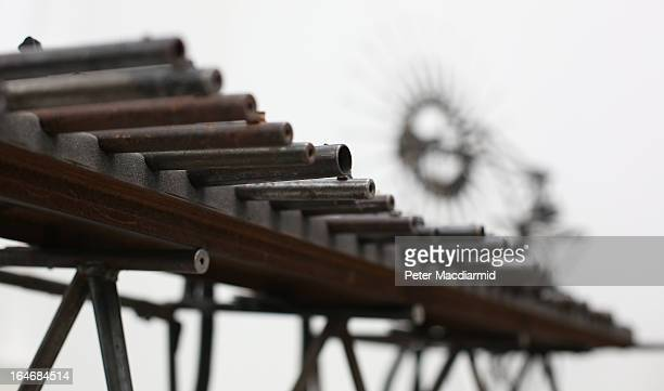 A musical instrument made from recycled gun parts is shown at Pedro Reyes' 'Disarm' exhibition at the Lisson Gallery on March 26 2013 in London...