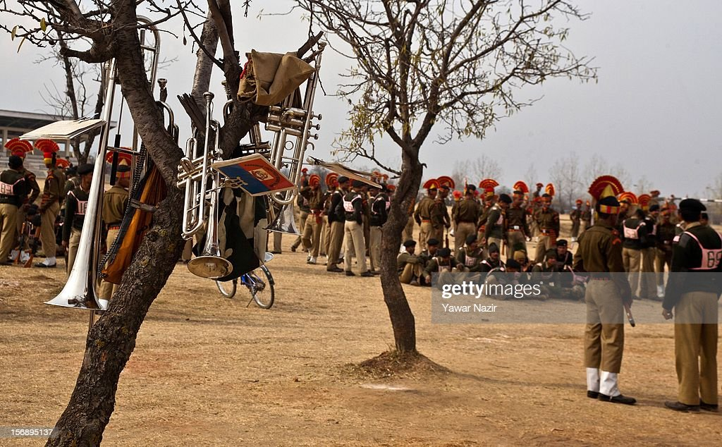 Musical instruments hang from a tree as Indian Border Security Force (BSF) soldiers attend their passing out parade on November 24, 2012 in Humhama, on the outskirts of Srinagar, the summer capital of Indian administered Kashmir, India. 545 new trained recruits of the Indian paramilitary Border Security Force constables took oaths during their passing out parade after successfully completing 36 weeks of basic training which involved physical fitness, weapons handling, map reading, counter-insurgency operations and human rights. The recruits will join Indian soldiers to fight militants in Kashmir, a spokesman of the paramilitary BSF said. India has already close to a million soldiers posted in Jammu and Kashmir, making the disputed Himalayan region one of the most militarized zone in the world
