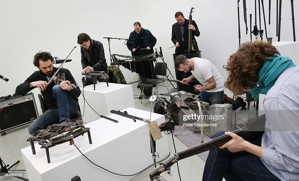 Musical instruments made from recycled gun parts are played at the Lisson Gallery on March 26, 2013 in London, England. Mexican artist Pedro Reyes received 6,700 destroyed weapons from the Mexican government from which he sculpted two groups of instruments. The first, a series titled Imagine, is an orchestra of fifty instruments, from flutes to string and percussion instruments, designed to be played live. The second, Disarm, is an installation of mechanical musical instruments, which can either be automated or played live by an individual operator using a laptop computer or midi keyboard.