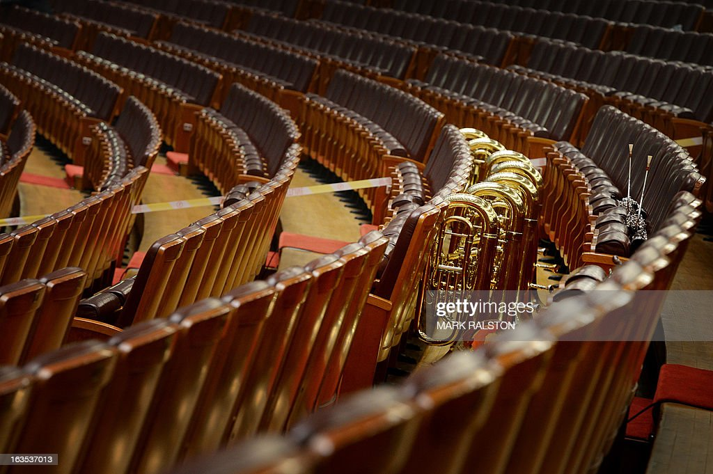 Musical instruments wait for the arrival of the orchestra during the closing session of the Chinese People's Political Consultative Conference (CPPCC) at the Great Hall of the People in Beijing on March 12, 2013. Thousands of delegates from across China met this week to seal a power transfer to new leaders whose first months running the Communist Party have pumped up expectations with a deluge of propaganda. AFP PHOTO/Mark RALSTON