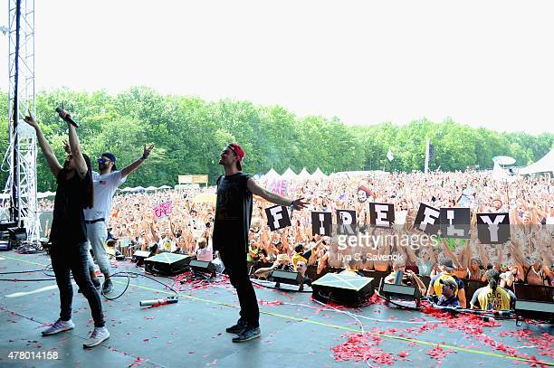 Musical producer Steve Aoki poses onstage for a photo with Alex Pall and Andrew Taggart of The Chainsmokers during day 4 of the Firefly Music...