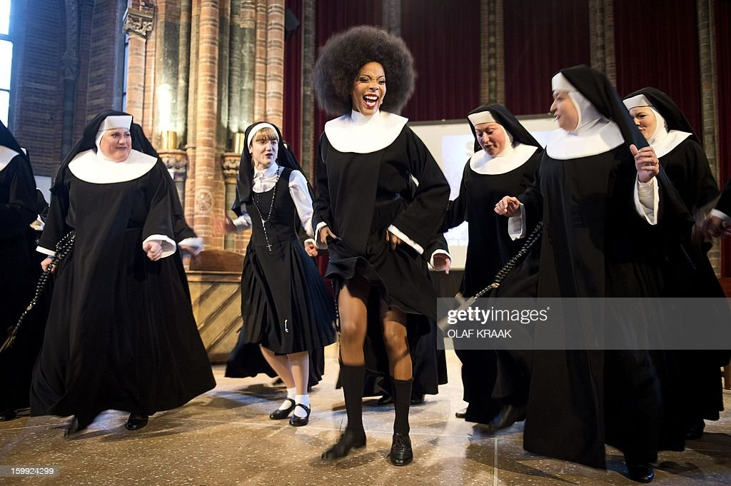 Musical singer and leading actress in the musical 'Sister Act' Carolina Dijkhuizen (C) performs during the press presentation at the Vondel Church in Amsterdam on January 23, 2013. The musical will premiere at the AFAS Circus Theatre in The Hague on March 3, 2013. AFP PHOTO / ANP - OLAF KRAAK netherlands out