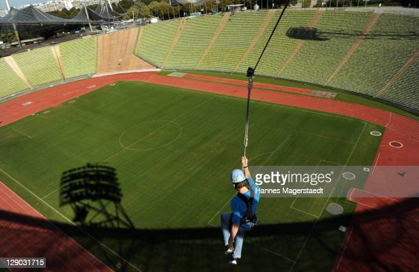 Musical Star Alexander Klaws flys on Munich Flying Fox above the Munich Olympiastadion on October 11 2011 in Munich Germany