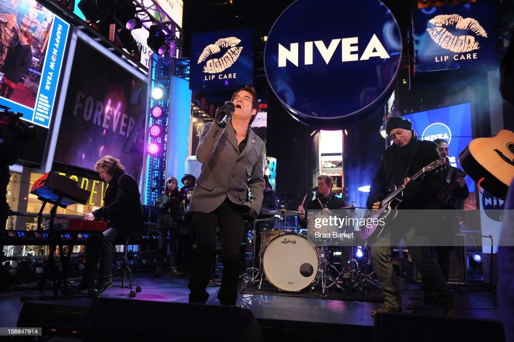 Musican group Train performs John Lennon's 'Imagine' on the NIVEA Kiss Stage in Times Square, where he rang in 2013 while helping others prepare for the 'Kiss of the Year'at Times Square on December 31, 2012 in New York City.