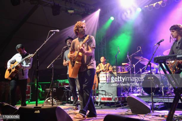 Musican Jack Johnson performs with ALO onstage at That Tent during day 1 of the 2013 Bonnaroo Music Arts Festival on June 13 2013 in Manchester...