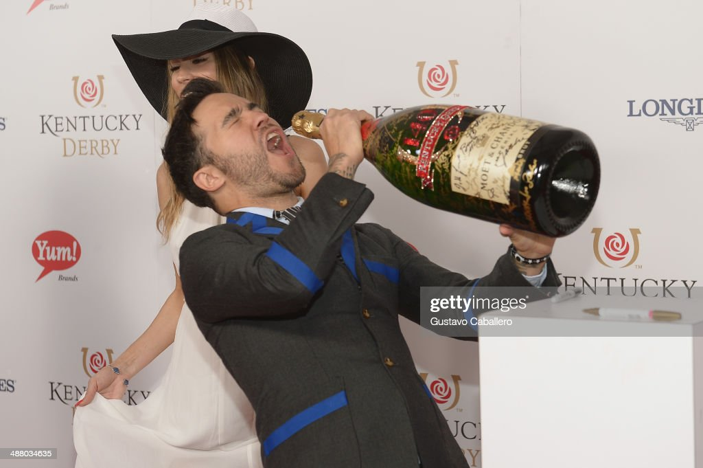 Musican <a gi-track='captionPersonalityLinkClicked' href=/galleries/search?phrase=Pete+Wentz&family=editorial&specificpeople=595892 ng-click='$event.stopPropagation()'>Pete Wentz</a> toasts with Moet & Chandon at the 140th Kentucky Derby at Churchill Downs on May 3, 2014 in Louisville, Kentucky.