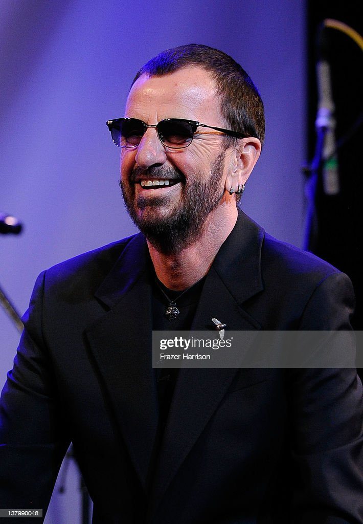 Musican <a gi-track='captionPersonalityLinkClicked' href=/galleries/search?phrase=Ringo+Starr&family=editorial&specificpeople=92463 ng-click='$event.stopPropagation()'>Ringo Starr</a> on stage at 'SiriusXM's Town Hall With <a gi-track='captionPersonalityLinkClicked' href=/galleries/search?phrase=Ringo+Starr&family=editorial&specificpeople=92463 ng-click='$event.stopPropagation()'>Ringo Starr</a>' And Host Russell Brand and Moderator Don Was Live On SiriusXM's The Spectrum Channel performs at Troubadour on January 30, 2012 in West Hollywood, California.