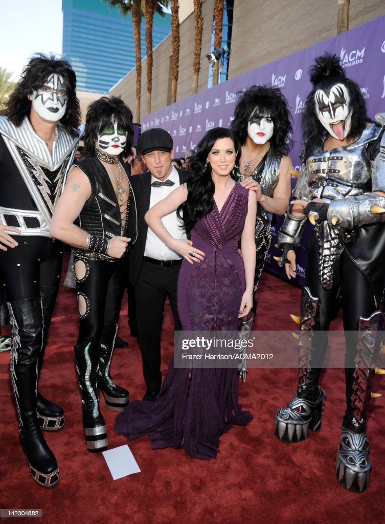 Musicans <a gi-track='captionPersonalityLinkClicked' href=/galleries/search?phrase=Tommy+Thayer&family=editorial&specificpeople=235930 ng-click='$event.stopPropagation()'>Tommy Thayer</a> and <a gi-track='captionPersonalityLinkClicked' href=/galleries/search?phrase=Eric+Singer&family=editorial&specificpeople=614320 ng-click='$event.stopPropagation()'>Eric Singer</a> of rock band Kiss, <a gi-track='captionPersonalityLinkClicked' href=/galleries/search?phrase=Keifer+Thompson&family=editorial&specificpeople=7618627 ng-click='$event.stopPropagation()'>Keifer Thompson</a> and <a gi-track='captionPersonalityLinkClicked' href=/galleries/search?phrase=Shawna+Thompson&family=editorial&specificpeople=7618655 ng-click='$event.stopPropagation()'>Shawna Thompson</a> of the band Thompson Square and Paul Stanley and <a gi-track='captionPersonalityLinkClicked' href=/galleries/search?phrase=Gene+Simmons&family=editorial&specificpeople=138593 ng-click='$event.stopPropagation()'>Gene Simmons</a> of Kiss arrive at the 47th Annual Academy Of Country Music Awards held at the MGM Grand Garden Arena on April 1, 2012 in Las Vegas, Nevada.