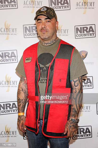 Musician Aaron Lewis arrives at the NRA Country ACM Celebrity Shoot Hosted By Blake Shelton at the Desert Hills Shooting Club on March 31 2012 in...