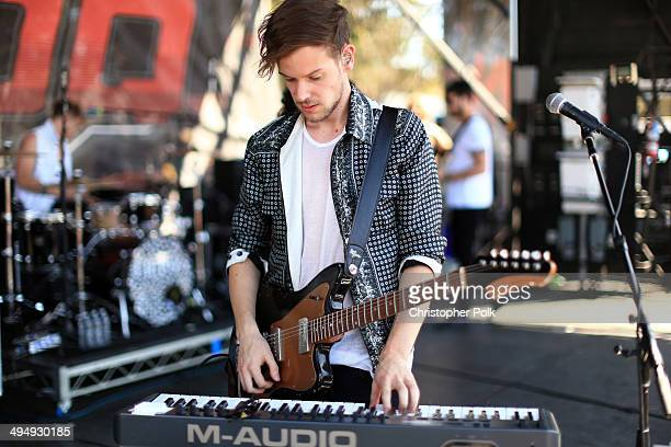 Musician Adam Hann of The 1975 performs onstage during the 22nd Annual KROQ Weenie Roast at Verizon Wireless Music Center on May 31 2014 in Irvine...