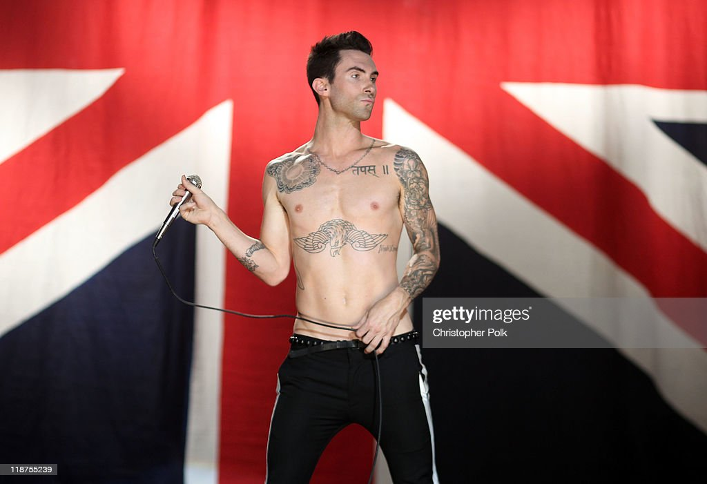 Musician Adam Levine of the band Maroon 5 performs at the Maroon 5 Video Shoot for 'Moves Like Jagger' with Christina Aguilera on July 8, 2011 in Los Angeles, California.