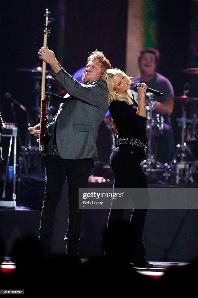 Musician Aden Bubeck (L) and singer Miranda Lambert perform onstage during the 2016 iHeartCountry Festival at The Frank Erwin Center on April 30, 2016 in Austin, Texas.