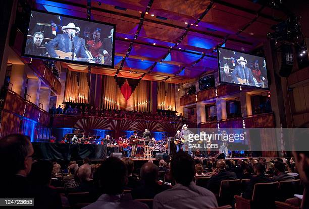 "Musician Alan Jackson performs during ""A Concert for Hope"" at the Kennedy Center in Washington DC September 11 on the 10th anniversary of the..."