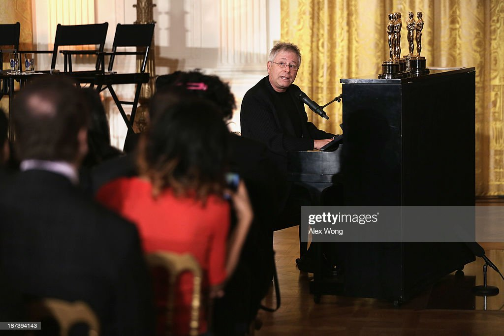 Musician Alan Menken plays piano and sings during a workshop for high school students from DC, New York and Boston about careers in film production November 8, 2013 at the East Room of the White House in Washington, DC. Students had an opportunity to hear from leaders in the industry about animation, special effects, makeup, costume, directing, music and sound effects.