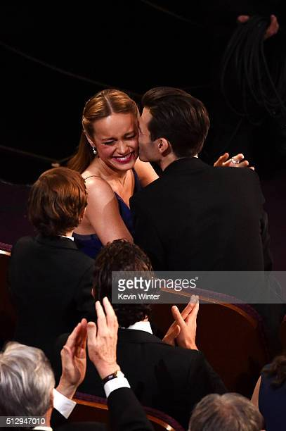 Musician Alex Greenwald kisses actress Brie Larson after she wins the Best Actress award for 'Room' during the 88th Annual Academy Awards at the...