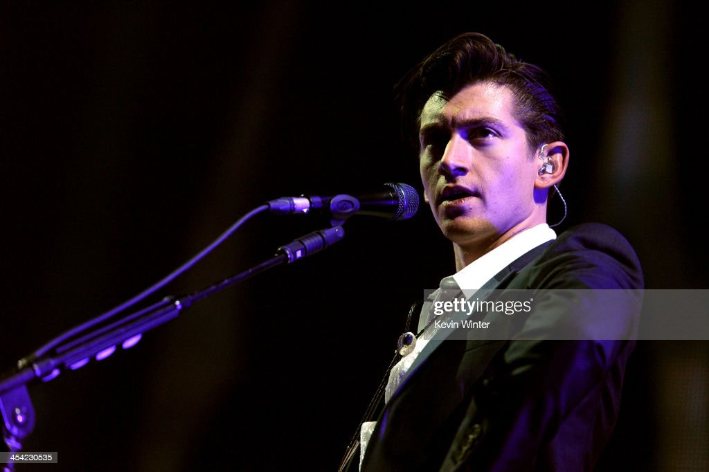 Musician <a gi-track='captionPersonalityLinkClicked' href=/galleries/search?phrase=Alex+Turner&family=editorial&specificpeople=706618 ng-click='$event.stopPropagation()'>Alex Turner</a> of Arctic Monkeys performs onstage during The 24th Annual KROQ Almost Acoustic Christmas at The Shrine Auditorium on December 7, 2013 in Los Angeles, California.