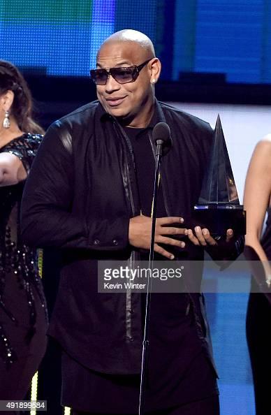 Musician Alexander Delgado of Gente de Zona accepts the award for 'Favorite Urban Duo or Group' onstage during Telemundo's Latin American Music...