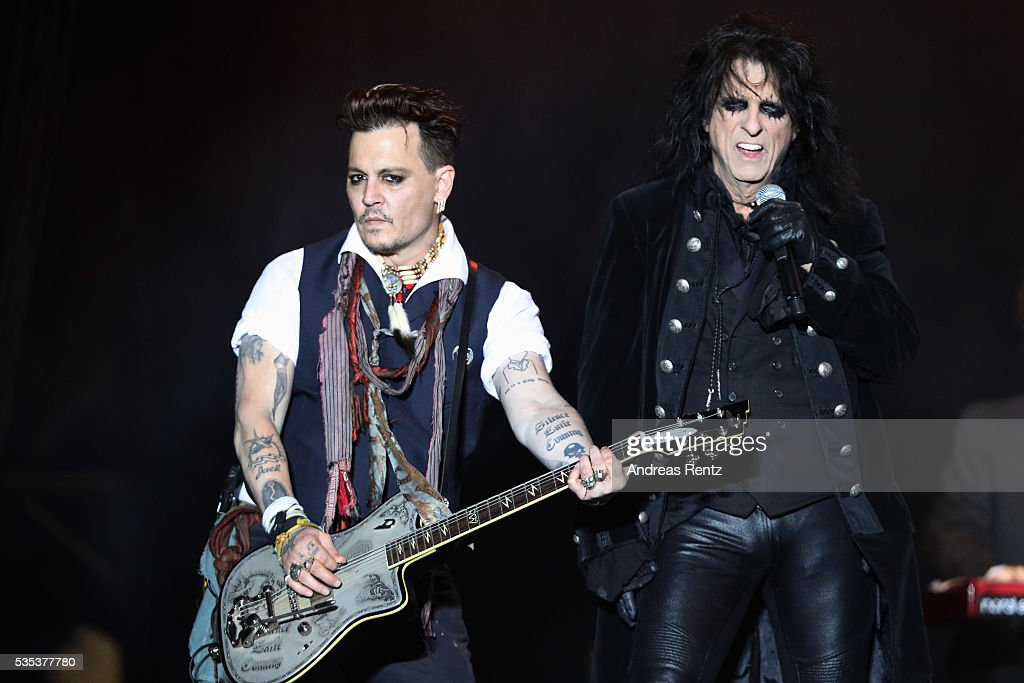 Musician <a gi-track='captionPersonalityLinkClicked' href=/galleries/search?phrase=Alice+Cooper&family=editorial&specificpeople=202989 ng-click='$event.stopPropagation()'>Alice Cooper</a> (R) and Actor/Musician <a gi-track='captionPersonalityLinkClicked' href=/galleries/search?phrase=Johnny+Depp&family=editorial&specificpeople=202150 ng-click='$event.stopPropagation()'>Johnny Depp</a> of Hollywood Vampires perform onstage at Hessentags-Arena during the 56th Hessentag on May 29, 2016 in Herborn, Germany.