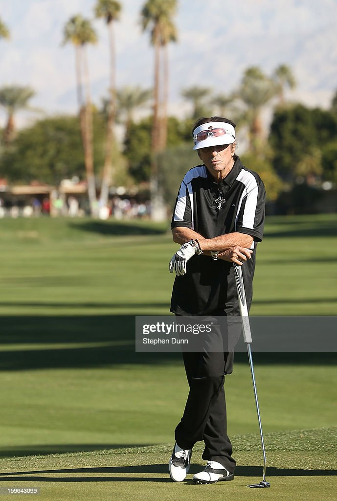 Musician Alice Cooper waits to putt on the sixth hole during the first round of the Humana Challenge in partnership with the Clinton Foundation at La Quinta Country Club on January 17, 2013 in La Quinta, California.