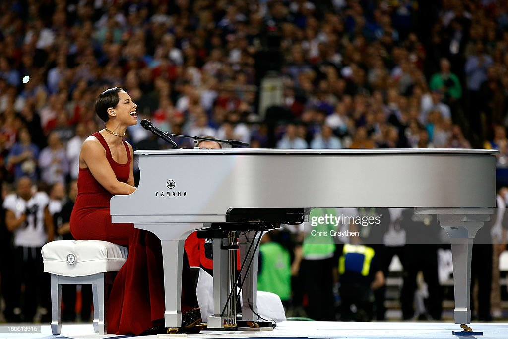 Musician Alicia Keys performs the National Anthem prior to the start of Super Bowl XLVII between the Baltimore Ravens and the San Francisco 49ers at the Mercedes-Benz Superdome on February 3, 2013 in New Orleans, Louisiana.