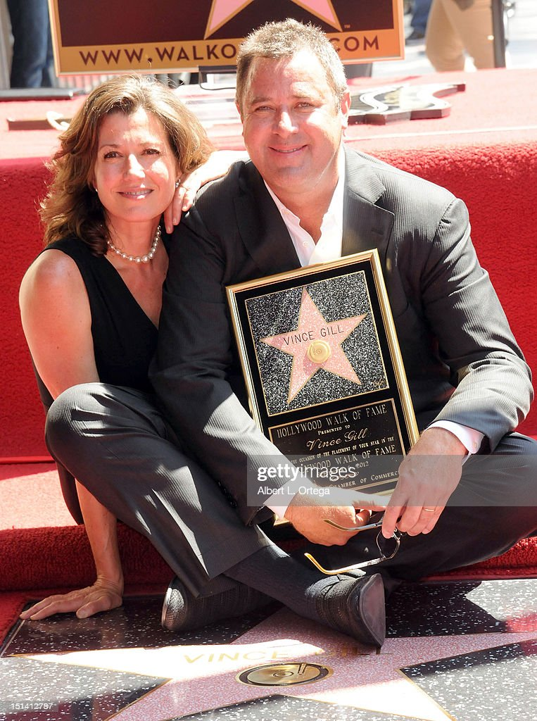 Musician Amy Grant and musician Vince Gill participate in the Star ceremony Honoring Vince Gill On The Hollywood Walk Of Fame on September 6 2012 in...