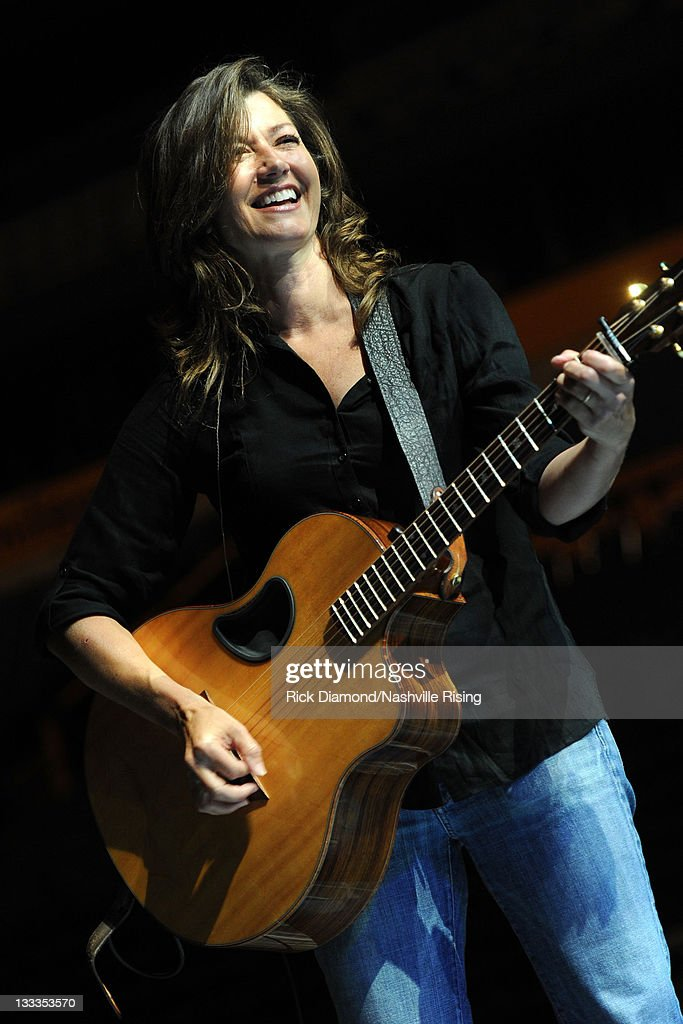 Musician Amy Grant performs onstage at Nashville Rising a benefit concert for flood relief at Bridgestone Arena on June 21 2010 in Nashville Tennessee