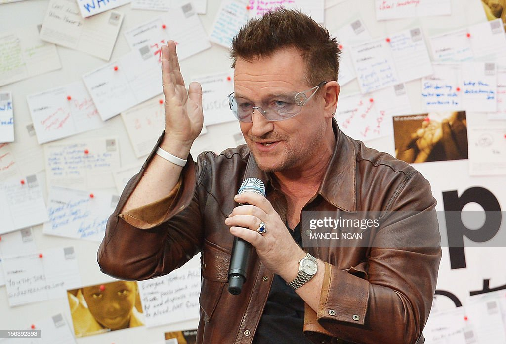 Musician and activist Bono speaks during a discussion on ending poverty on November 14, 2012 in the atrium of the World Bank Headquarters in Washington, DC. AFP PHOTO/Mandel NGAN