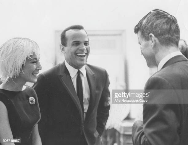Musician and actor Harry Belafonte Julie Belafonte and former Senator and Attorney General Robert Kennedy laughing April 14 1962