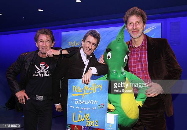 Musician and author Peter Maffay and director Rufus Beck pose for the press prior to the 'Tabaluga live' press conference at O2 World on May 16 2012...