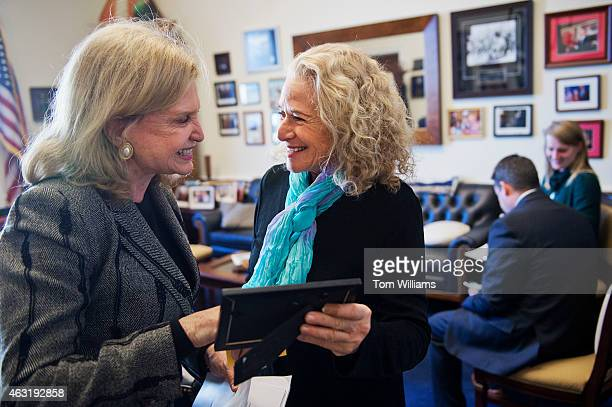Musician and conservationist Carole King right and Rep Carolyn Maloney DNY talk before a news conference in Rayburn Building on the reintroduction of...