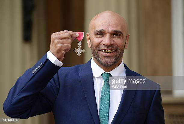 Musician and DJ Goldie whose real name is Clifford Price after being made an MBE by the Prince of Wales during an Investiture ceremony at Buckingham...
