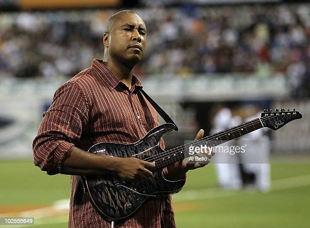 Musician and former baseball player of the New York Yankees Bernie Williams plays the national anthem on his guitar before the game between the New...