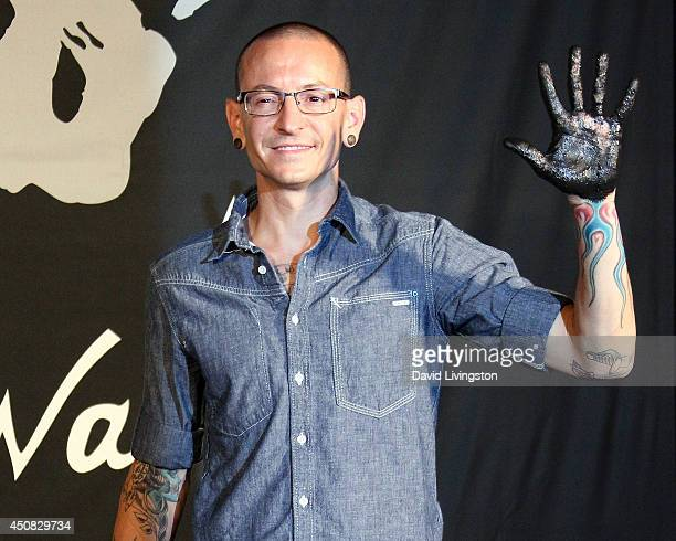 Musician and Linkin Park band member Chester Bennington attends Linkin Park's induction into the Guitar Center's RockWalk at Guitar Center on June 18...