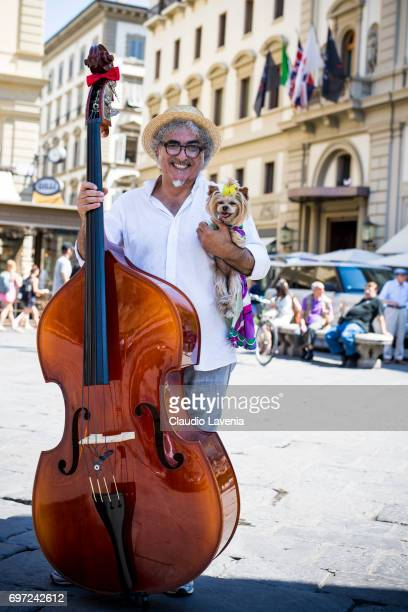 Musician and Little Lola Sunshine the dog poses for photographer wearing Emilio Pucci dress during Pitti Immagine Uomo 92 on June 12 2017 in Florence...