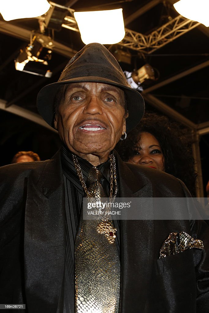 US musician and manager Joe Jackson arrives on May 24, 2013 for the screening of the film 'Michael Kohlhaas' presented in Competition at the 66th edition of the Cannes Film Festival in Cannes. Cannes, one of the world's top film festivals, opened on May 15 and will climax on May 26 with awards selected by a jury headed this year by Hollywood legend Steven Spielberg.