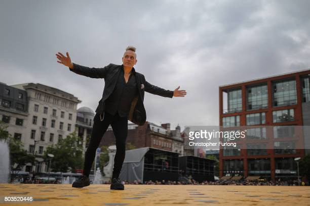 Musician and singer John Robb parades on a 100m long catwalk installed high above the ground as part of What Is The City But The People show in...