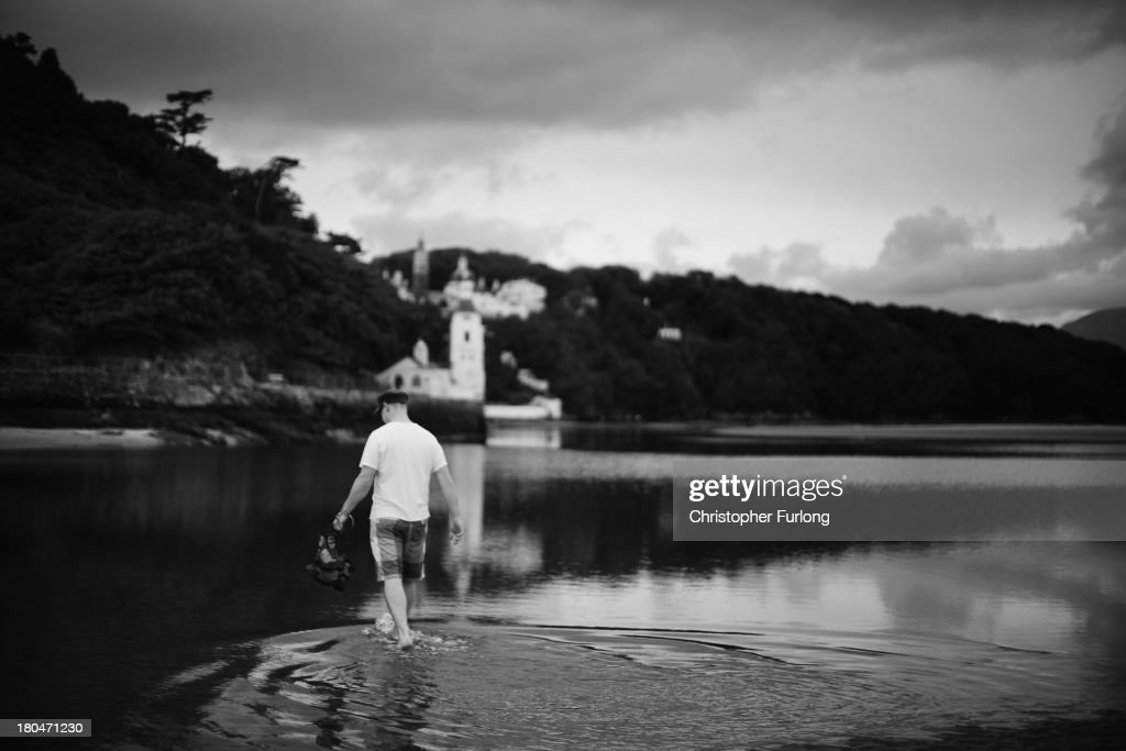 Musician Andrew Clucas enjoys a paddle in the sea as festival fans arrive for Festival No. 6 on September 13, 2012 in Portmeirion, United Kingdom. The classic Italianate village of Portmeirion in North Wales is staging its second No. 6 Festival, named after the famous 1960's cult TV series ''The Prisoner'' which was filmed in the village. The award winning three day festival is a kaleidoscope of entertainment with music, art and performances ranging from poetry to pop and classical music.