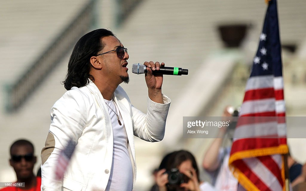 Musician <a gi-track='captionPersonalityLinkClicked' href=/galleries/search?phrase=Andy+Andy&family=editorial&specificpeople=666095 ng-click='$event.stopPropagation()'>Andy Andy</a>, also known as 'El Astro de la Bachata,' sings on the West Lawn of the U.S. Capitol during the All In for Citizenship immigration reform rally April 10, 2013 on Capitol Hill in Washington, DC. Tens of thousands of reform supporters gathered for the rally to call on Congress to act on proposals that would grant a path to citizenship for an estimated 11 million of the nation's illegal immigrants.