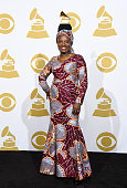 Musician Angelique Kidjo winner of the Best World Music Album Award for 'Eve' poses in the press room during The 57th Annual GRAMMY Awards at the...