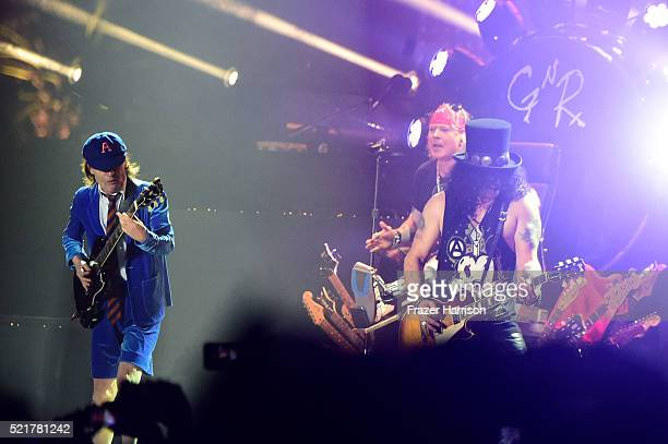 Musician Angus Young of AC/DC performs onstage with Axl Rose and Slash of Guns N' Roses during day 2 of the 2016 Coachella Valley Music Arts Festival...