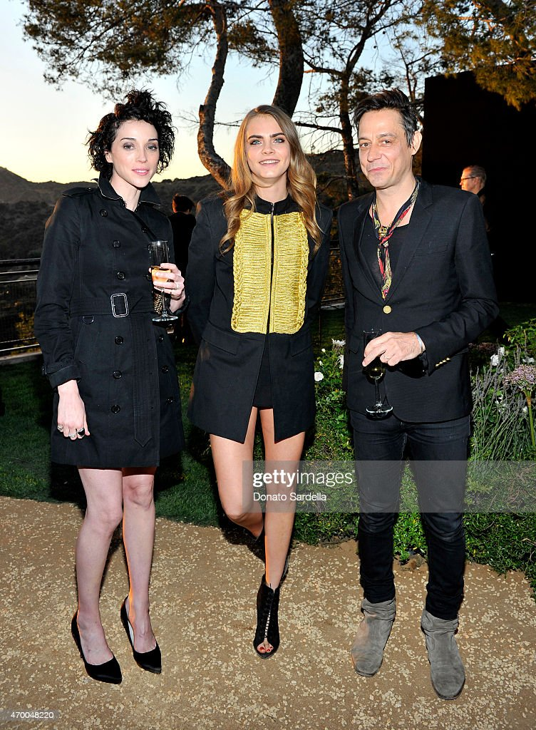 Musician Annie Clark, model Cara Delevingne and musician Jamie Hince of The Kills attend the Burberry 'London in Los Angeles' event at Griffith Observatory on April 16, 2015 in Los Angeles,