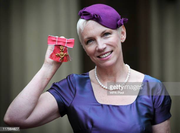 Musician Annie Lennox poses with her OBE which she received from Queen Elizabeth II at Buckingham Palace June 28 2011 in London England