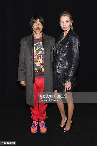 Musician Anthony Kiedis and guest pose backstage at the Marc Jacobs fashion show during MercedesBenz Fashion Week Fall 2015 at Park Avenue Armory on...