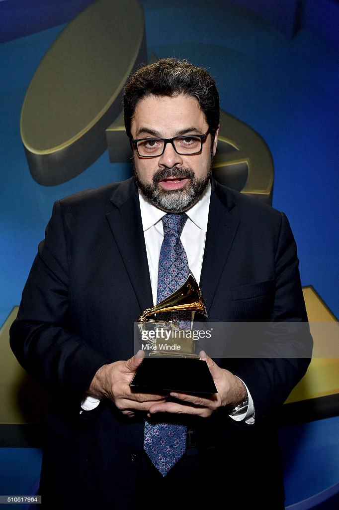 Musician <a gi-track='captionPersonalityLinkClicked' href=/galleries/search?phrase=Arturo+O%27Farrill&family=editorial&specificpeople=6649010 ng-click='$event.stopPropagation()'>Arturo O'Farrill</a> poses with award for Best Instrumental Composition during the GRAMMY Pre-Telecast at The 58th GRAMMY Awards at Microsoft Theater on February 15, 2016 in Los Angeles, California.