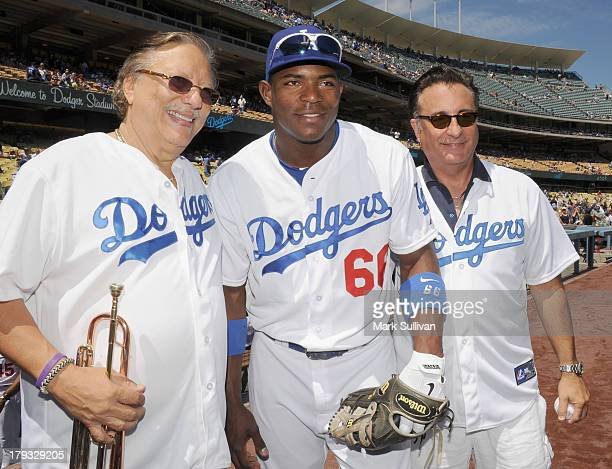 Musician Arturo Sandoval Los Angeles Dodger outfielder Yasiel Puig and actor Andy Garcia on the field before the MLB game between the San Diego...