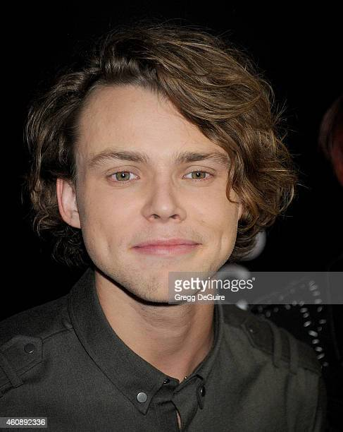 Musician Ashton Irwin of 5 Seconds of Summer arrives at The PEOPLE Magazine Awards at The Beverly Hilton Hotel on December 18 2014 in Beverly Hills...