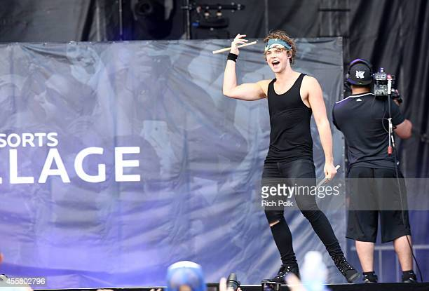 Musician Ashton Irwin of 5 Seconds of Summer performs onstage during the 2014 iHeartRadio Music Festival Village on September 20 2014 in Las Vegas...