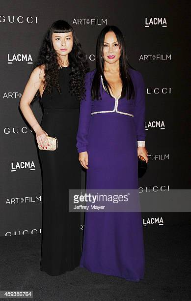 Musician Asia Chow and Film Gala CoChair LACMA Trustee Eva Chow attend the 2014 LACMA Art Film Gala honoring Barbara Kruger and Quentin Tarantino...