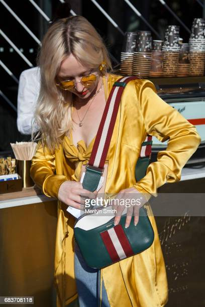 Musician Asta wearing all Hansen and Gretel vintage sunglasses Bally bag and Gucci shoes during MercedesBenz Fashion Week Resort 18 Collections at...